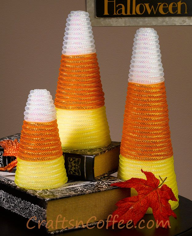 Fun & easy candy corn craft made with Styrofoam cones and deco mesh tubing. Love these! CraftsnCoffee.com.