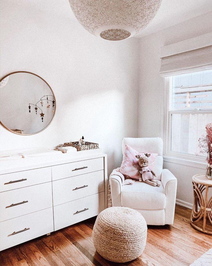 interior design / baby nursery room / wood crib / pottery