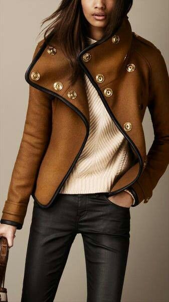 I love this brown Burberry jacket. It is sturdy enough to last through winter but the black trim and gold snaps make it perfect for fall wear in the city. Would dress up any outfit.