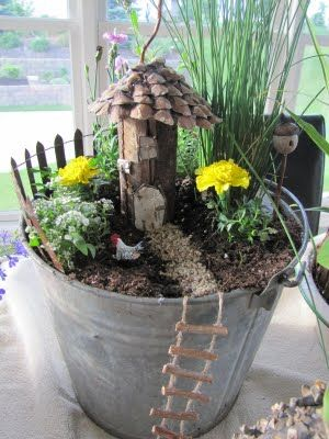 Fairy Garden in a Bucket! I love the rope for the fairy to get down.