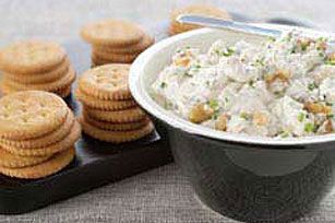 Serve this creamy spread of cream cheese, blue cheese, sour cream, chopped walnuts and chives with crackers for an easy-and-enticing appetizer.