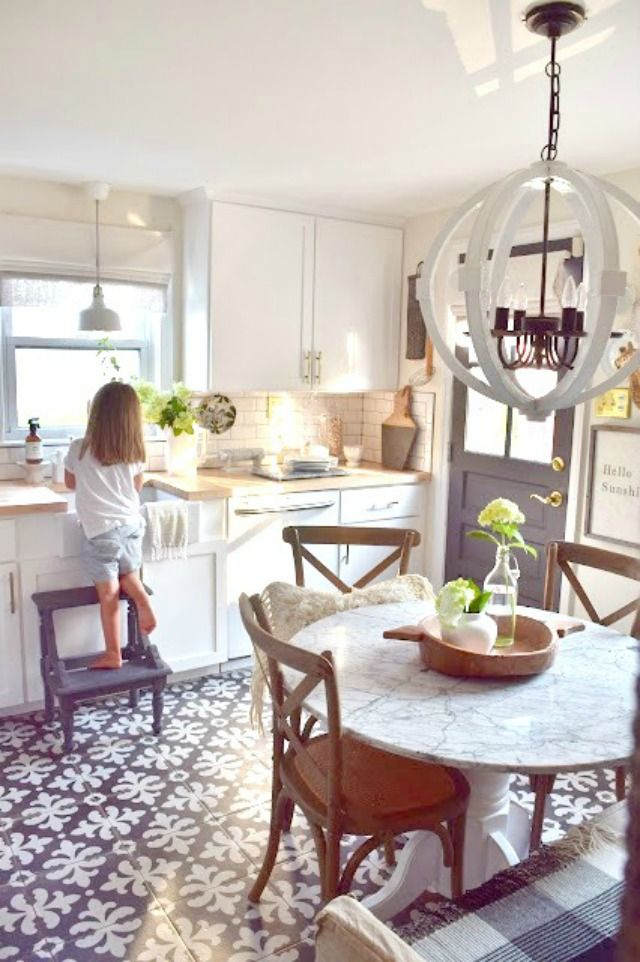 Eclectic Home Tour of Nesting with Grace - love this vintage/modern kitchen and those beautiful graphic tiles eclecticallyvintage.com