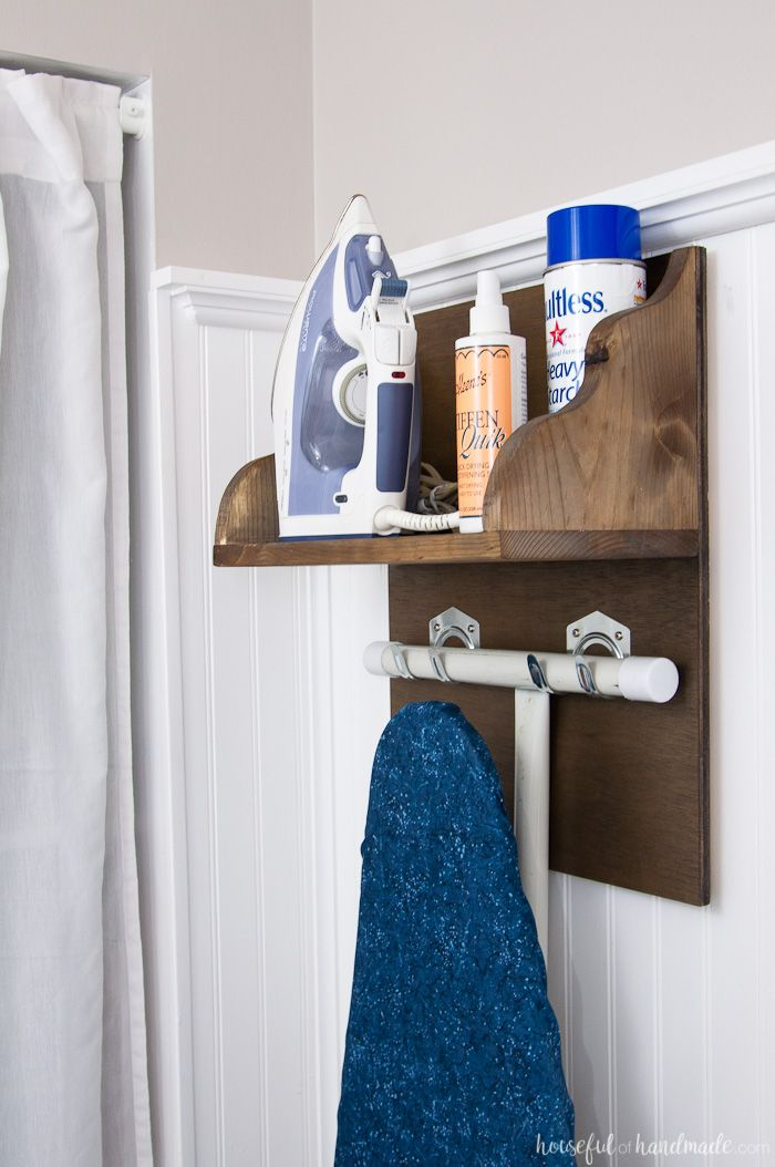 Create the perfect place to store your iron and supplies. This easy DIY Iron Holder with Ironing Board Storage is a quick build that will keep your laundry room or craft room organized. Free build plans on Housefulofhandmade.com   Laundry Room Storage Ideas   Ironing Board Hanger   Iron Shelf   Things to Build with Scraps   $100 Room Challenge