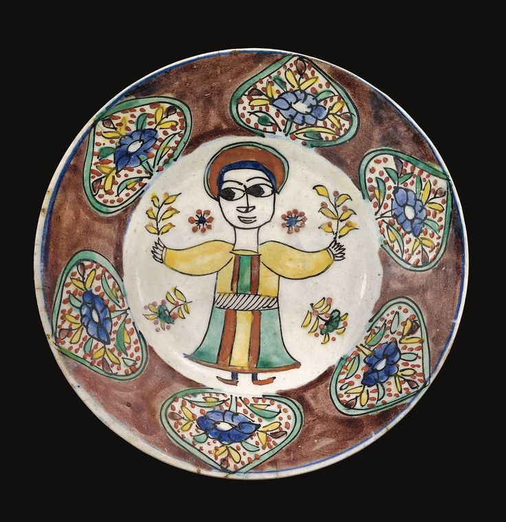 A Kutahya Pottery Dish with design of a wide-eyed youth, Turkey, mid-18th century