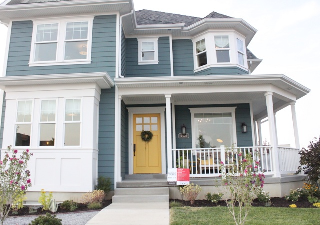 Beautiful blue gray siding with yellow door from danielle for Blue house builders