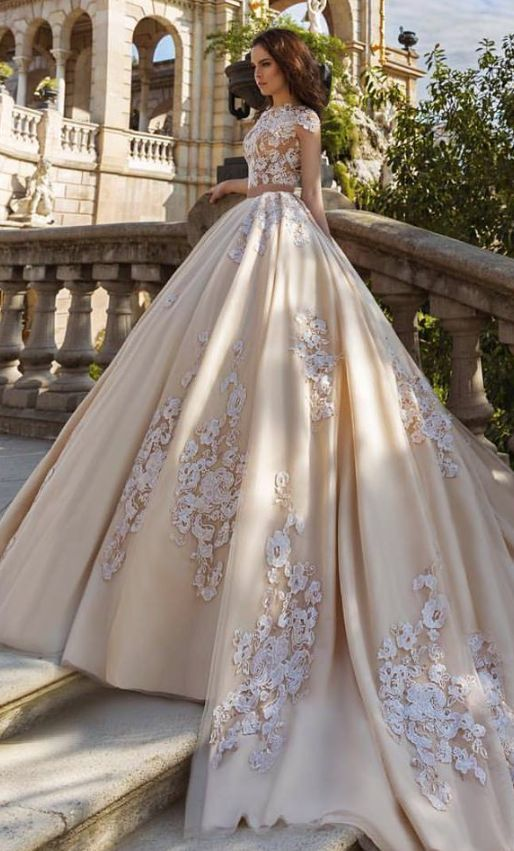 Unique floral applique cropped ballgown wedding dress in a pale yellow color; Featured Dress: TM Crystal Design