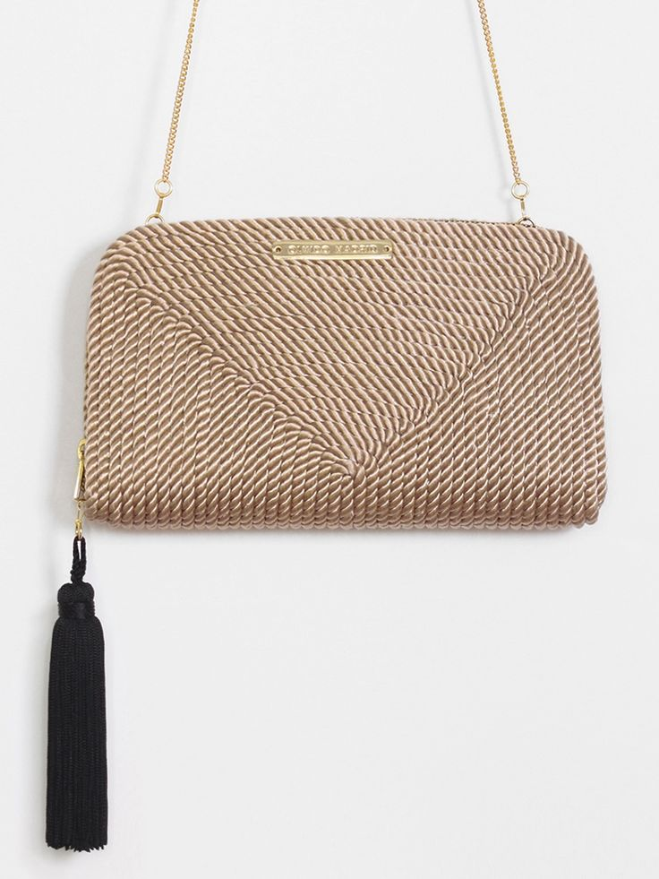 The product Bolso de fiesta Jimena · Nude is sold by OLVIDO MADRID in our Tictail store.  Tictail lets you create a beautiful online store for free - tictail.com