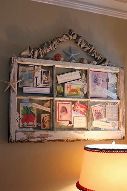 Love this! Pictures and mementos affixed to the glass of a salvaged window.