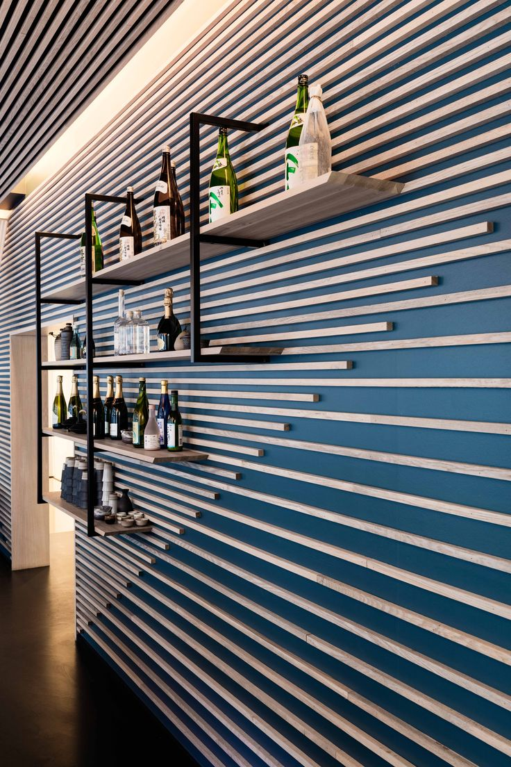 Karma Sushi Restaurant, Aarhus, Denmark. Three natural core materials and a deep Scandinavian blue gives a Nordic atmosphere that is combined with a Japanese tranquility elegance.