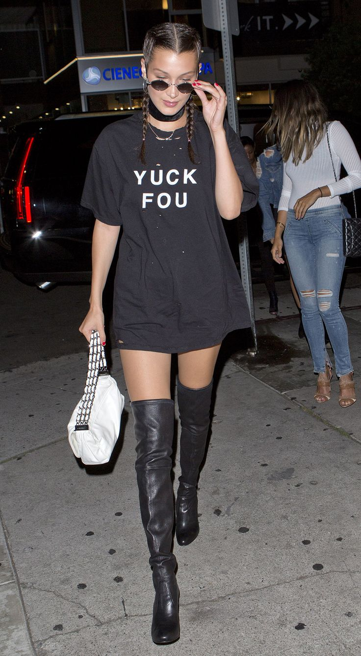 We are all over Bella's all-black-everything get-up. Braids, badass thigh-high boots, strong choker game and an oversized slogan tee = low-key outfit perfection.