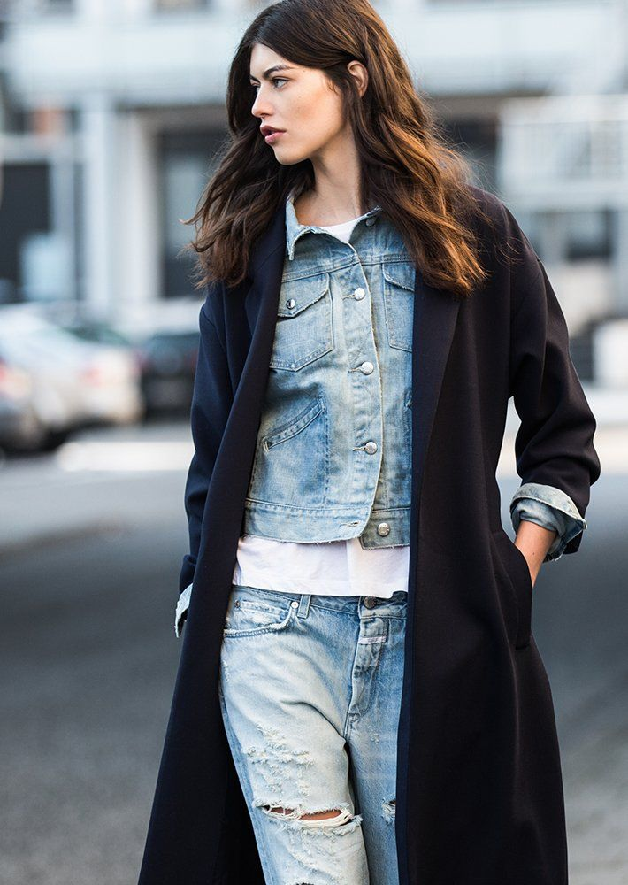 long black coat layered over a denim jacket & ripped jeans #style #fashion #streetstyle