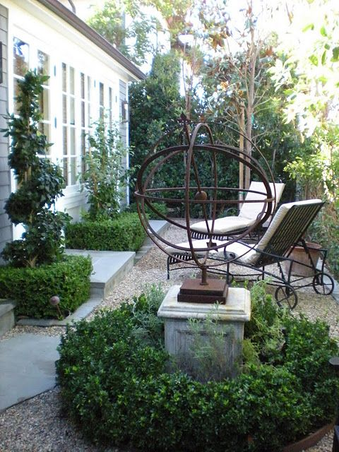 ..boxwood and spiral topiary...