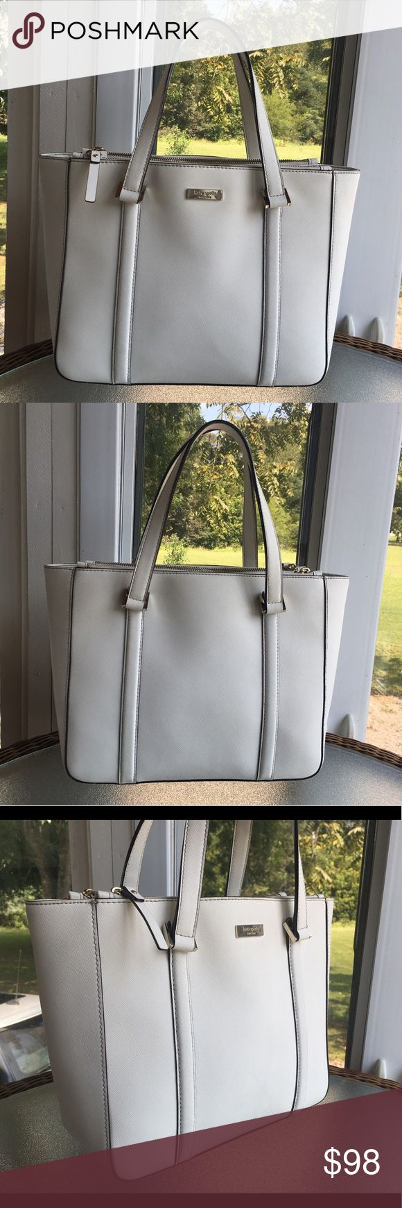 """♠️Kate Spade♠️Newbury Lane Cadene ♠️Kate Spade♠️Newbury Lane Cadene (Natural Ivory Color )  Good condition.Saffiano leather.Open center with magnetic closure with zippers compartment on either side of the center.Interior and exterior is clean.Dual handles are good condition.No damage,No rips,and No tears.Has some scratches on gold plate hardware.Came from a smoke free and pet free home.I'm willing to negotiate through the offer button.  Size: 12"""" W x 10"""" H x 4.5"""" D Handles drop: 7"""" kate…"""