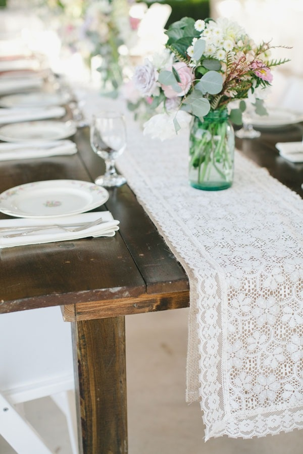 Farm table, lace runner, mason jars