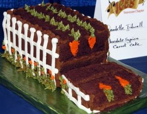 Chocolate carrot cake with a white picket fence. Love.