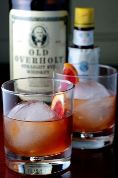 Blood Orange Old Fashioned:  2 ounces whiskey   1/2 teaspoon sugar  2 teaspoons fresh blood orange juice  2 dashes Angostura bitters  Blood orange wedge  Large ice cube(s)