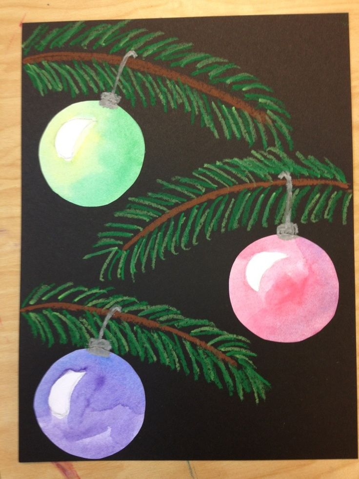 Oil pastel pine branches with analogous water-colored ornaments... Tried this with 5th grade and they turned out great!
