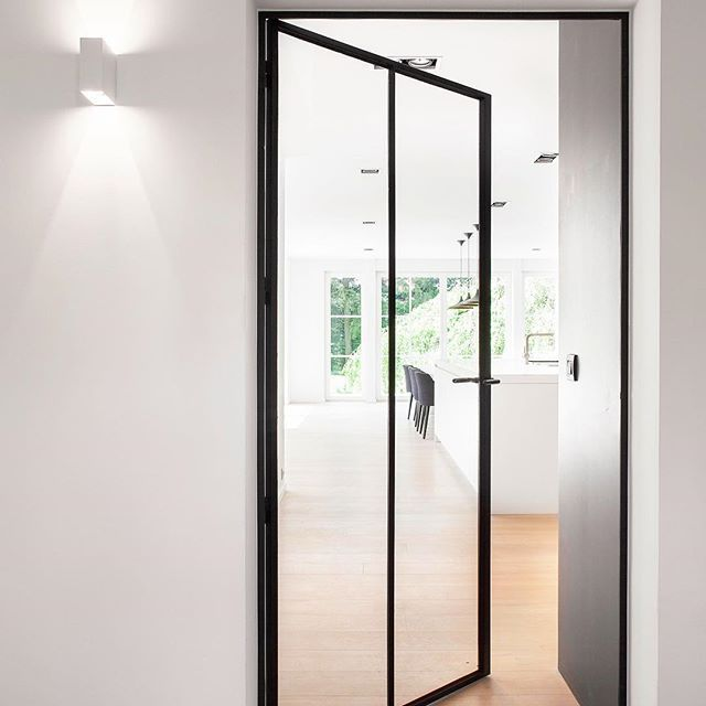 // EXTRA WIDE, Steel Frame Internal Doors... Yes. You. Can :) Photo by @annick_vernimmen_photography for Home Metal. Team DS. X #designstuff #interiordesign #architecture #annickvernimmenphotography #belgium #belgiandesign #steel #steelframe #steelframeddoors #minimal #minimalist #interiorinspiration #black #white #kitchen #kitchendesign #kitcheninspiration
