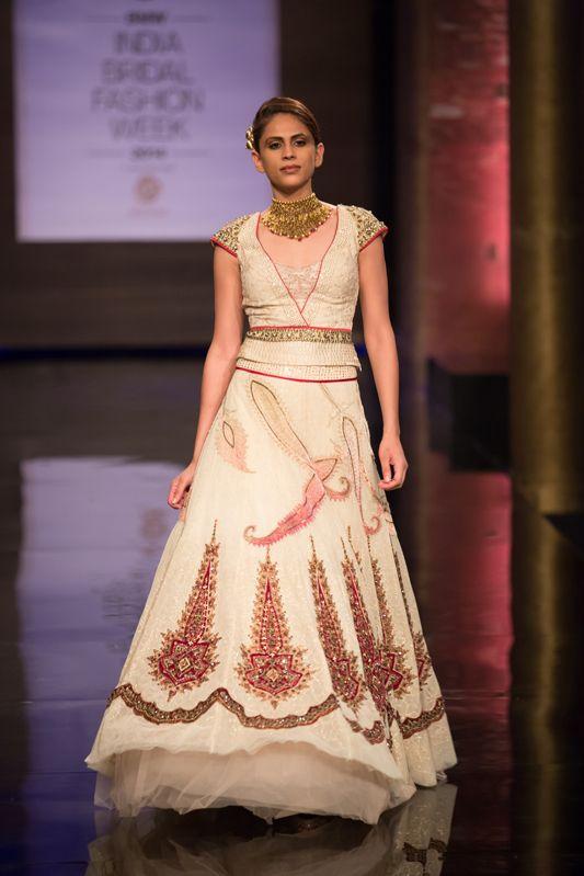Ivory cream tulle Indian wedding lehnga by JJ Valaya at India Bridal Fashion Week. More here: http://www.indianweddingsite.com/bmw-india-bridal-fashion-week-ibfw-2014-jj-valaya/