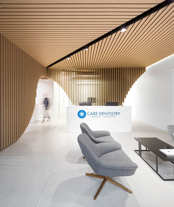 pedra silva architects crafts undulating timber feature in sydney dental clinic