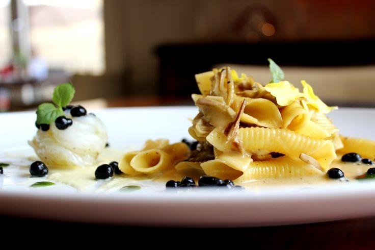 Garganelli cacio e pepe with artichokes cream, cuttlefish and black ink caviar
