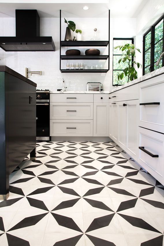 Modern Kitchen With Black And White Elongated Diamond Tiles By Granada Tile Kitchen Floor Tile Patterns White Tile Kitchen Floor Patterned Floor Tiles