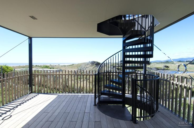 Stairs with a view, anyone? These iron stairs look simply stunning on this wooden deck.