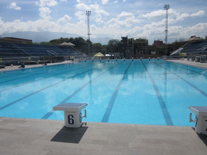 Outdoor Olympic size lap pool at Atanasio Girardot Sports Complex in Medellin Colombia - Estadio metro station - SoloTripsAndTips.com #swimming