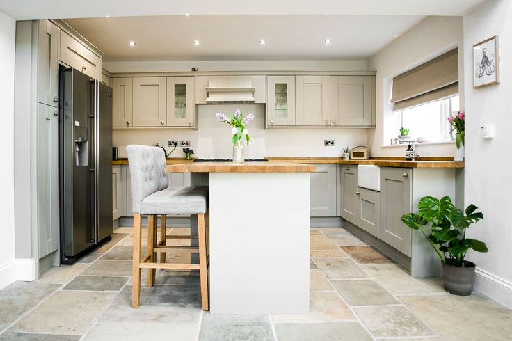 Shaker kitchen renovation with reclaimed radiators and slate flooring
