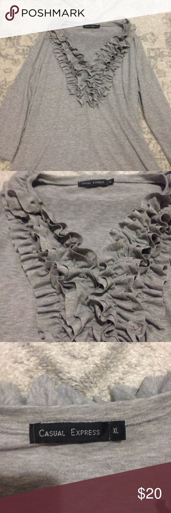 Casual Express XL Gray/Grey Ruffle V-Neck Top! Casual Express XL Gray/Grey Women's Top. V-Neck. Ruffles around the neck and at the top of the back (please see pictures). 3/4 sleeves. Excellent used condition, barely worn if at all. Non-smoking household. Check out my ratings and buy with confidence! Thanks for stopping by my closet! Casual Express Tops Tees - Long Sleeve