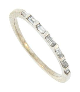 A string of seven brilliant diamond baguettes are set into the face of this 14K white gold estate wedding band. The elegant wedding ring measures 1.40 mm in width. Circa: 1950. Size 5 1/2. We can re-size slightly.