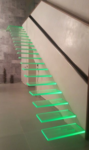 Color:This floating staircase has a unique quality of light to it. The lighted stairs show a bright green color that, depending on the area of the stair, have different shades and tints of green displayed.