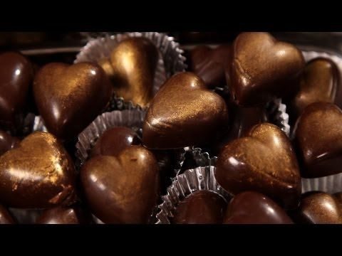 ▶ How to Add Filling to a Chocolate Mold | Candy Making - YouTube... I would add organic coconut manna with mint in the middles!!!
