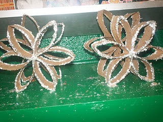 Toilet Paper Roll Snowflakes. Cut tp roll into 1 inch pcs. Glue together in snowflake formation. Dip in plate of glue, then plate of glitter!