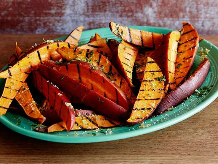 Garlic and Herb Grilled Sweet Potato Fries : The secret to perfect firm-tender texture is parboiling the sweet potatoes before grilling, Bobby advises.