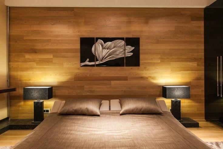 Интерьер спальни с отделкой стены ламинатом
