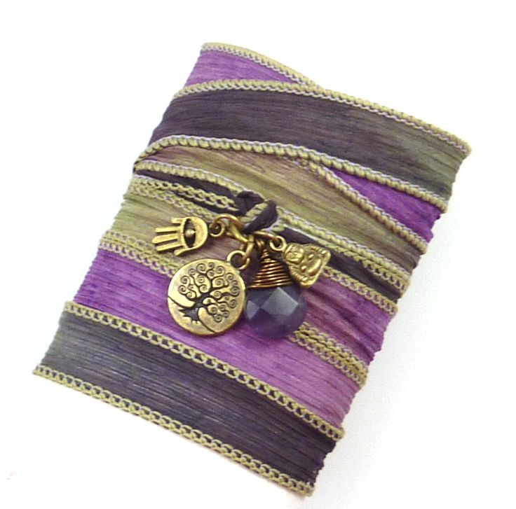 Gorgeous colored hand painted silk ribbon with antique brass tree of life, hamsa, buddha, and a genuine amethyst wire wrapped briolette. -The tree of life symbolizes many things, including wisdom, protection, strength, bounty, beauty, and redemption. -A hamsa possess magical powers of protection, happiness and prosperity. -The Buddha is believed to enhance good luck and wealth and is also a symbol of wisdom and compassion.