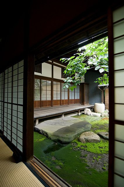 Shoji screens out to a modern koi pond with waterfalls would be so tranquil
