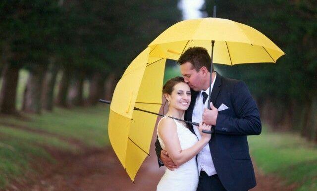 Slight rain but bright yellow umbrella made for a beautiful photo