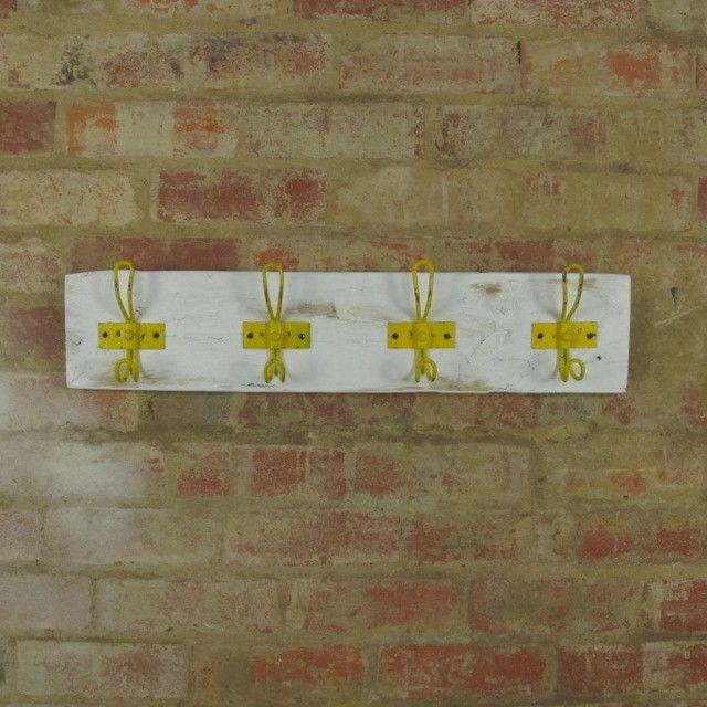 White painted timber coatrack with retro yellow hooks