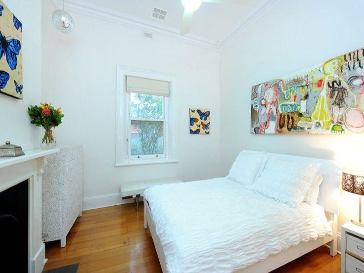 Children's room bedroom design idea with floorboards & fireplace using brown colours - Bedroom photo 314570
