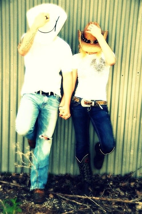 Engagement photo...Country love maybe Andrew with a baseball hat and me with my cowgirl hat