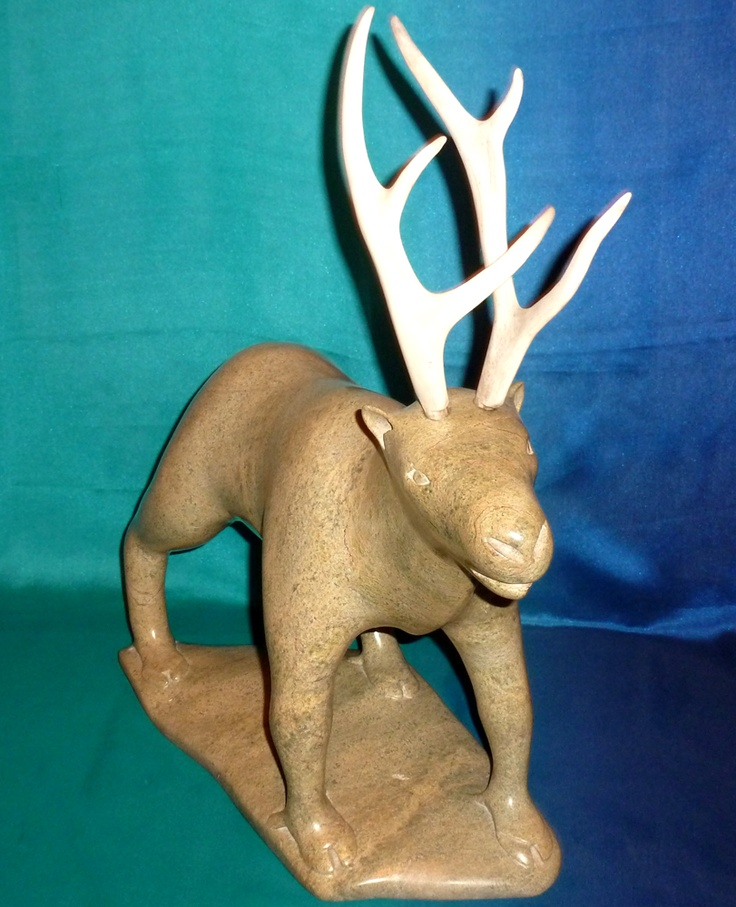 """Item # S7109   Price: C$7,750  Subject: Allert Caribou   Dated: c.1990's - Signed  Artist: Qimirpik, Nuyaliaq       Community: Kimmirut        Size: inches/cm 12.5"""" x 16"""" x 6""""  31.8 cm x 40.6 cm x 15.2 cm     Description: size does not includes Antlers    This caribou carries the spirit of earlier carvings into more recent times with its elegant simplicity.  This beautiful beast will make an attractive and important addition to any serious collection."""