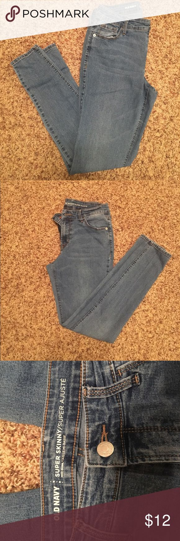 Mid rise old navy skinny jeans High waisted VERY soft skinny jeans. Thin material that is semi stretchy. Used to be my favorite pair of jeans but still have lots of life left in them! Perfect for hiding a little bit of extra tummy 🙈🙊 Old Navy Jeans Skinny