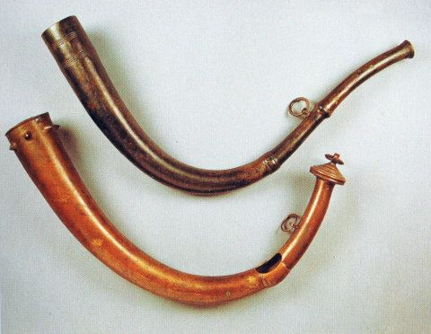 These two Late Bronze Age horns were discovered in Co. Antrim at bogs located in Drumbest and Drunkendult respectively. Made from bronze they were originally cast in clay moulds. They represent sophisticated pieces of early metal-working and were undoubtedly valuable items, whose deposition in a bog may represent ritual activity.