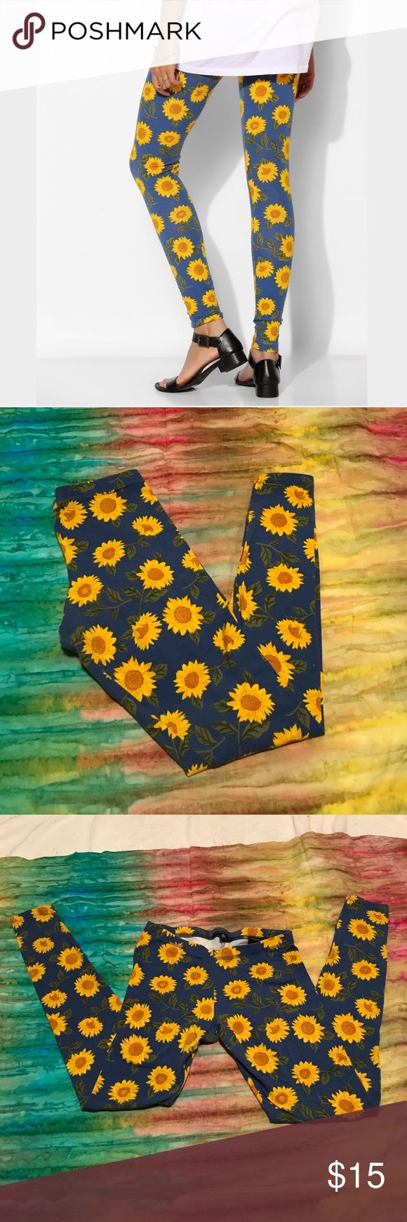Urban outfitters sunflower leggings Adorable blue leggings with sunflower pattern. Worn once. Truly madly deeply from urban outfitters. Urban Outfitters Pants Leggings