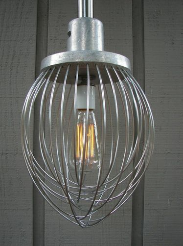 Light fixture by Rodger Thomas is made from an old industrial whisk