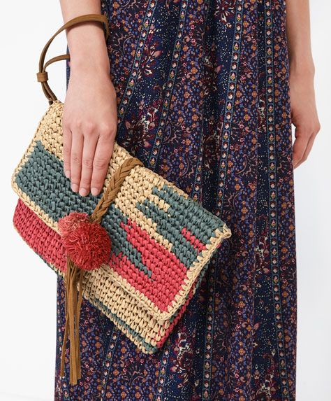 Little painted raffia bag - New In - Autumn Winter 2016 trends in women fashion at Oysho online. Lingerie, pyjamas, sportswear, shoes, accessories, body shapers, beachwear and swimsuits & bikinis.