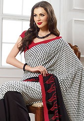 Make a trendy look with this classic printed saree. This off white, black and red georgette saree is nicely designed with floral print work. Saree gives you a singular and dissimilar look. Matching red blouse is available. Slight color variations are possible due to differing screen and photograph resolution.
