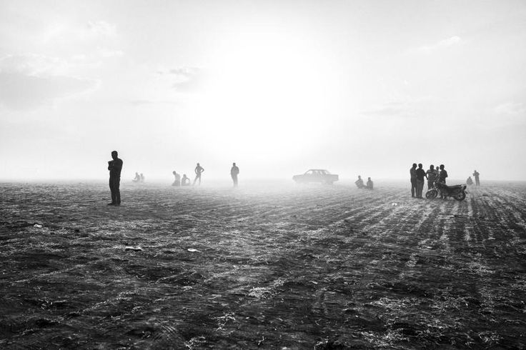 Kurdish Syrian refugees from Kobani, Syria wait near the Turkish-Syrian border, Sept. 2014, as the Islamic State of Iraq and Levant (ISIS/ISIL) began an attack on the city, eventually overtaking it in Oct. 2014. Children and elderly crossed mine fields separating Kobani from the Turkish border, in an effort to flee the fighting. According to UNHCR, 170,000 inhabitants of Kobani took refuge in the camps in Turkey.